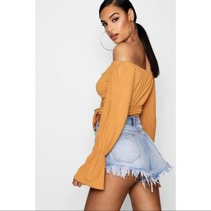 c7cbe5d6034 PrettyLittleThing Tops - Ruched Tie Front Long Sleeve Off Shoulder Top
